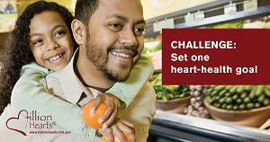 African-American man and his daughter walking through grocery store. Image text: Challenge: Set one heart-health goal.