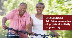 African-American man and woman riding bikes together. Challenge: Add 10 more minutes of physical activity to your day.