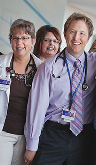 Group of doctors smiling.
